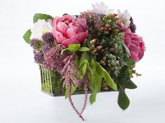 A beautiful pink and green wedding centerpiece | Sustainable Wedding Flowers | Green Bride Guide