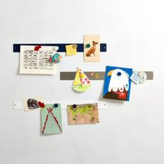 It's the bulletin board, stripped-down.  Colorful magnetic metal strips ideal for hanging notes or pictures in a bedroom, mudroom or entryway. Details, details Includes wall mounting hardware Magnets not includedShow 'em what you're made of Powder-coated metal.