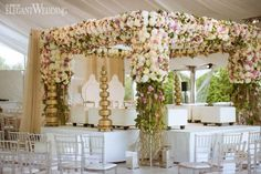Stunning floral arch for an Indian wedding! ENCHANTING INDIAN WEDDING www.elegantwedding.ca