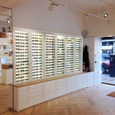 Opticien sortie Juin 2016 - Parquet chevron, laque mat, laiton et chêne JC Giardina Architecte & Charline Piette Architecte Intérieur