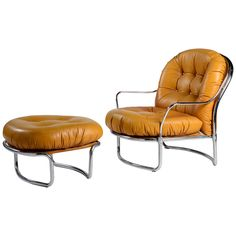 Model 915 leather lounge chair with ottoman by Carlo De Carli