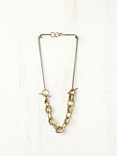 This Free People Necklace converts to a bracelet... so simple, smart and prett!