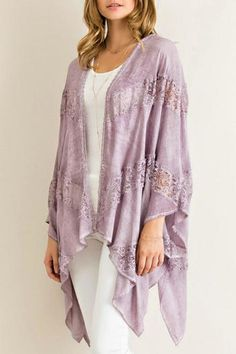 Acid wash open kimono featuring handkerchief hem with lace paneling in throughout. Semi sheer. Unlined. Woven.