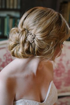 A loose and romantic updo, accessorized with a sparkly vintage brooch. | Photo by by millie b photography