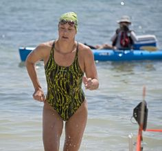 In this photo provided by the Florida Keys News Bureau, Dale LeClair, emerges from the Atlantic Ocean as the top individual finisher of the ...