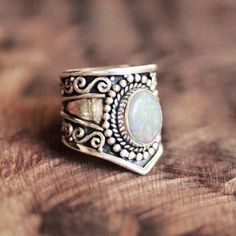 A Gypsy style solid 925 Sterling Silver ring with a large solid white Opal…