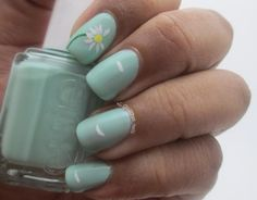 He loves me he loves me not nails :) The white daisy looks awesome on the minty base.