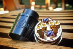 Dual Flat Twisted coils built on Icon RDA.  Pic credit: @vapeisgrate  Icon RDA was designed by Mikevapes, featuring with an overall diameter of 24mm and a squonk pin. Suitable for both single and dual coil build, yet dual coil build is suggested so as to get the best flavor out of this Icon RDA