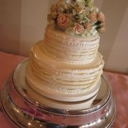 Textured pleats in butter cream on this wedding cake.  Cakes By Graham, More Than Just the Icing on the Cake.  http://richmondcakes.com/