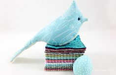 My newest Kid Giddy dies with Sizzix include this little tufted BIRD die with a little panel to make a nest full of baby bird eggs.