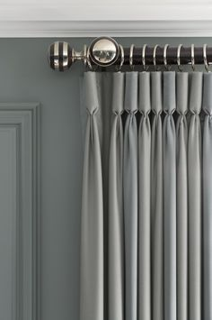 Hang curtains as high as possible. - ELLEDecor.com