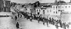 Armenians are marched to a nearby prison in Mezireh by armed Turkish soldiers, 1915. (photo credit: Artaxiad, Wikimedia Commons)