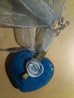 Deep Blue Stone with ribbons.