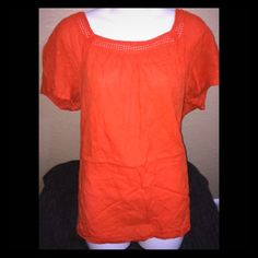 St. John's bay orange cotton top Very gently used. Beautiful shade of orange , perfect for spring. Has a beautiful collar and dotted texture. Plus size top, fits nice and loosely. St. John's Bay Tops Blouses