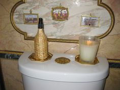 "Howard Slatkin likes to burn a scented candle in his powder, always one from Nest Fragrances.  Custom "" sunflower"" toilet button from P. E.  Guerin."