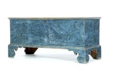 """AMERICAN CHIPPENDALE DECORATED BLANKET CHEST.  Early 19th century, pine. Dovetailed case with high scrolled bracket feet and its original blue decoration. 24""""h. 49.5""""w. 20""""d."""