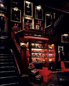 Love everything, but the pictures collection on the staircase is fab {The Gentlemen's Library: Ralph Lauren Chicago}