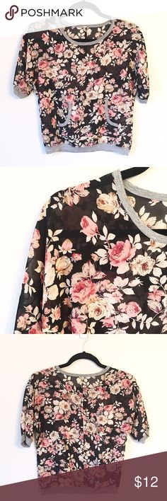 Rose Blouse This pretty rose and black blouse is slightly sheer and has a gray collar and hem. It also features a front pocket. Reasonable offers welcome and don't forget to bundle for a discount. Xoxo-J Tops Blouses