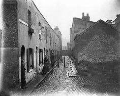 Little Collingwood Street, Bethnal Green 1900, by John Galt. Galt worked as a missionary for the methodist London City Mission. He took photographs in the East End to illustrate lectures which he gave up and down the country to raise funds for the mission's work. The photographs were taken primarily to show that those whom the mission sought to help, though poor, were nevertheless worthy of salvation.