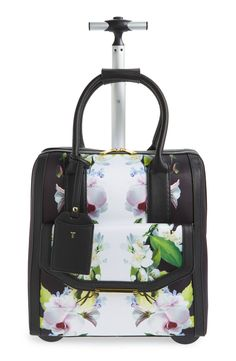 With its gorgeous mirrored floral print and polished hardware, this lightly structured travel bag from Ted Baker turns any getaway into a stylish event. Travel Packing, Travel Backpack, Travel Bags, Travel Ideas, Bath And Beyond Coupon, Simple Bags, Travel Accessories, Travel Style, Ted Baker