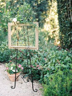 Classic wedding sign idea - mirror sign with elegant calligraphy and greenery {Photo courtesy of LVL Weddings & Events}