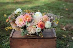 Love 'n Fresh Flowers autumn centerpiece with gold crab apples, fennel, sage, and dahlias