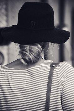 low bun + sun hat