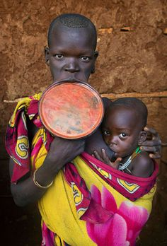 Africa | Suri Woman With A Lip Plate And Her Baby, Kibish, Omo Valley, Ethiopia | ©Eric Lafforgue