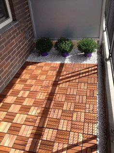 Small terrace facelift using interlocking wooden tile blocks from Ikea but, with a little time & fussing, you could replicate this look on your own.
