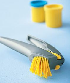 """Garlic press used to make Play-Doh hair.  Make Play-Doh """"hair"""" by filling the chamber and squeezing."""