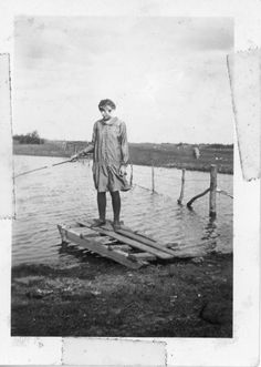 Geraldine Kenler fishing in a slough | saskhistoryonline.ca