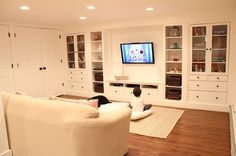 Wall of built Ins out of IKEA Hemnes cabinets :: Hometalk - an interesting DIY project
