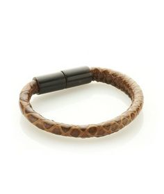 Fortunata Lubrano Zahir bracelet - 100% Made in Italy Tubular python skin bracelet with magnetic lock in dark, streaked horn.Designer: Fortunata Lubrano. Diameter: 5mm. Circumference: 19cm. Available. - See more at: http://www.ibavenue.com/products/woman/fortunata-lubrano/bracelets/092144391421822090629673/fortunata-lubrano-zahir-bracelet-100-made-in-italy-.html#sthash.OlMLnwH6.dpuf