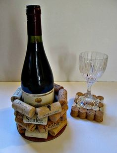 """Wine Cork Bottle Holder, Wine Bottle Cozy, Wine Bottle Coaster, Wine Bottle Trivet This great bottle holder is made from stacked wine corks securely glued together and attached to a cork and plastic base. A champagne bottle was used as a guide for the inner diameter so it is roomy enough for just about any size bottle! Corks may vary but there will always be a good variety. Measures ~ 6"""" wide x 4"""" tall. Inner diameter is about 3 1/2""""."""