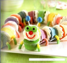 Colorful Caterpillar Cupcakes: I have a 2 year old who's favorite book is The Very Hungry Caterpillar. She's a huge fan of these cupcakes :) Cupcakes Gourmet, Cupcake Recipes, Mini Cupcakes, Cupcake Ideas, Cupcake Art, Party Cupcakes, Yummy Cupcakes, Rainbow Cupcakes, Colored Cupcakes