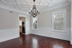 Dining Room with plaster ceiling detail, applied wainscot, and asian walnut floors. Benjamin Moore Balboa Mist decorpad.com