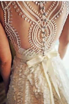 The detailing on the back of this gown is to DIE for! #SocialblissStyle #wedding #dress #gown
