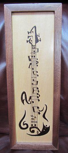 Made this as a gift for a musician friend....burned on basswood with a walnut frame.  I got the image from the internet and would love to make mention of the artist, but there is no pertinent information with the image.....still, kudos to a talented and imaginative artist for coming up with this piece.  June 2014