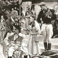 Behind the scenes shot of director Victor Fleming and Judy Garland during the Munchkinland set filming.