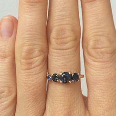 deep blue bicolor sapphires from Sri Lanka set in 14k yellow gold. mociun