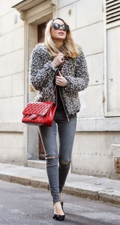Caroline Louis is wearing a grey fluffy jacket from Goodnightmacaroon