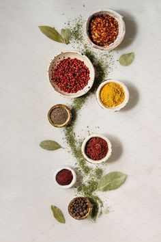 Spices seasoning and herbs variety in ceramic bowls. Different ground peppers, chili pepper, turmeric, bay leaf, cinnamon over white marble background. Food Poster Design, Food Design, Spice Logo, Tienda Natural, Food Wallpaper, Food Photography Tips, Spices And Herbs, Food Backgrounds, Gaudi