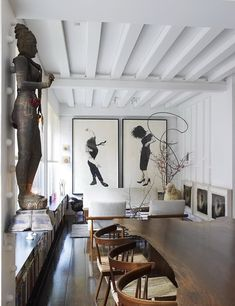 Source: Ngoc Minh Ngo Sunday funday! How fab is this living room? Loving all the woods and oversized art!