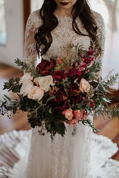 Love this oversized boho bouquet of burnt burgundies and raspberry with peach, cream and dusty green fine foliage.