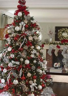 Christmas DIY: Tree toppers are a m Tree toppers are a must for an elegant display. Silver Stretch Net ribbon and loops of Red Velvet Glitter ribbon add the finishing touch to this gorgeous Christmas tree. Noel Christmas, Christmas 2017, Simple Christmas, Christmas Tree Red And Silver, Christmas Mantles, Silver Decorated Christmas Trees, Vintage Christmas, Christmas Tree Themes Colors Red, Christmas Ornaments