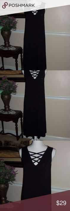Philosophy black dress M Stunning black dress by Philosophy! Figure flattering too. Great for any time of year!! Soft and flowy! 95% rayon, 5% spandex. Care: Machine wash cold. Gentle cycle. Philosophy Dresses Midi