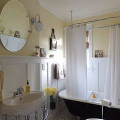 Custom wainscoting restores vintage charm to this Victorian style bathroom. | thisoldhouse.com/yourTOH