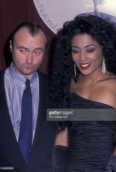 Phil Collins and Florence Joyner attend Annual International Emmy Awards on November 1988 at the Sheraton Hotel in New York City. Phil Collins, Flo Jo, Jesse Owens, Michael Johnson, Black Goddess, Sport Icon, Black Celebrities, Beautiful Women, Beautiful Images