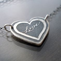Etched sterling silver love necklace    My dearest Logan got me this for Christmas. :)