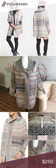 Free People Oversized Cardigan Sweater Coat, Cape Brand new with tags this super cozy oversized cardigan sweater jacket will keep you warm and snuggly this fall. 2 pocket front, multi-color, chunky knit. Size Medium would easily fit a large also. Poly-wool-cotton-mohair blend. PRICE IS FIRM! NO BUNDLING THIS ITEM! ANY ATTEMPTS TO BUNDLE WILL BE CANCELED! Free People Sweaters